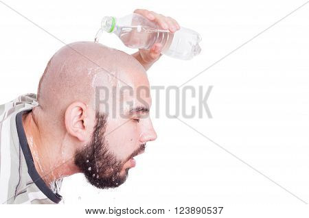 Man refreshing or cooling his head with cold water in summer heat concept isolated on white