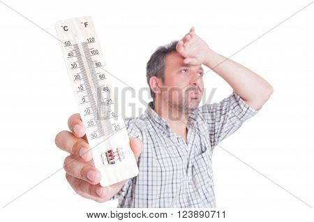 Sumer heat and heatwave concept with man holding thermometer isolated on white