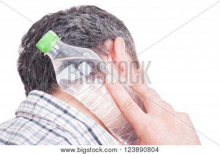 Man cooling back of the neck using cold water plastic bottle
