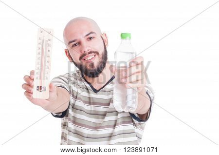 Hot summer and dehydration concept with man holding thermometer and cold water bottle