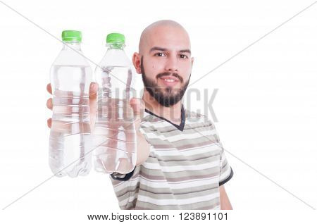 Happy man holding two bottles of cold water as hydration in summer heat concept