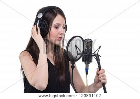 Young woman in headphones, recording of vocal on white background