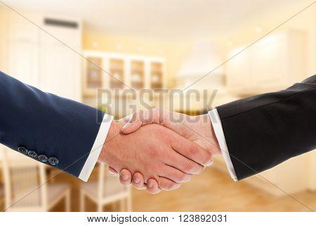 Buy Or Sale Real Estate Concept With Businessmen Handshake
