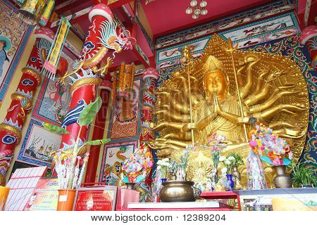 Golden Kuan in chinese style pavilion.