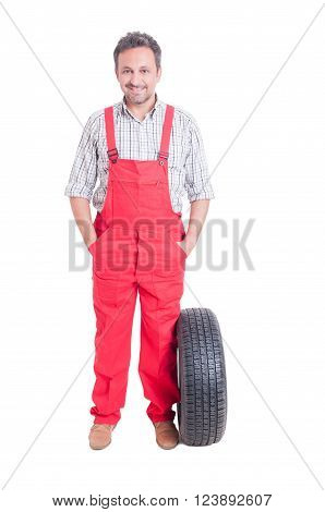 Friendly And Trustworthy Mechanic Standing With Hands In Pockets