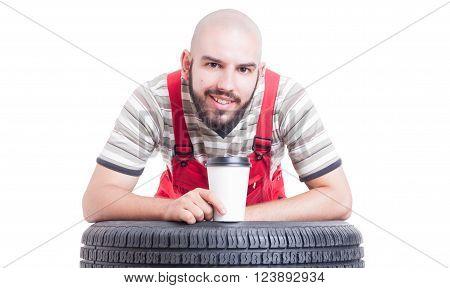 Mechanic Taking A Coffee Break