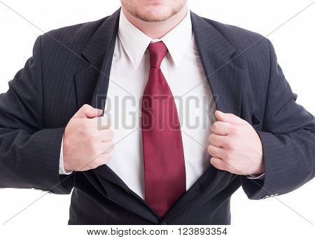 Super hero businessman concept with open suit jacket showing chest isolated on white