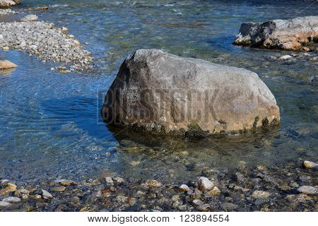 Big Stone In A Riverbed