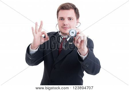 Medical Doctor Holding Stethoscope And Showing Okay And Perfect Gesture
