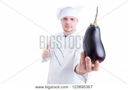 Chef Or Cook Holding An Eggplant And Showing Like