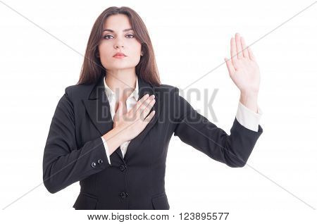 Young Female Lawyer Making Oath Gesture With Hand On Heart