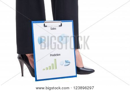 Sexy Business Woman Feet And Financial Reports With Charts