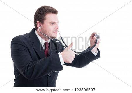 Male Doctor Holding Stethoscope And Showing Like And Thumb-up Gesture
