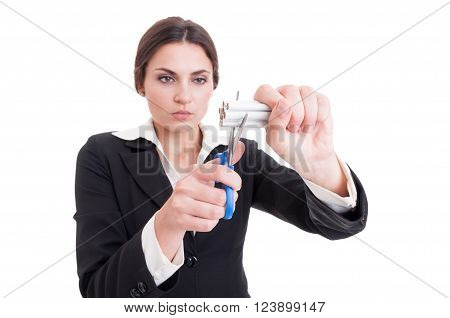 Woman Cutting A Bunch Of Cigarettes Using Scissors Or Shears