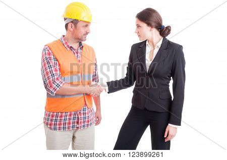Male engineer and business woman shaking hands as partnership and teamwork concept isolated on white background