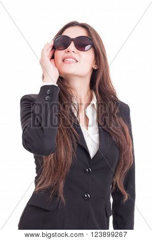 Young business woman wearing glasses acting like a fashion diva isolated on white studio background
