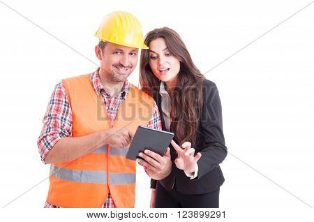 Smiling Modern Builder And Business Woman Using Wireless Tablet Pc