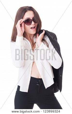 Young formal elegant female model acting sexy with open shirt and shades