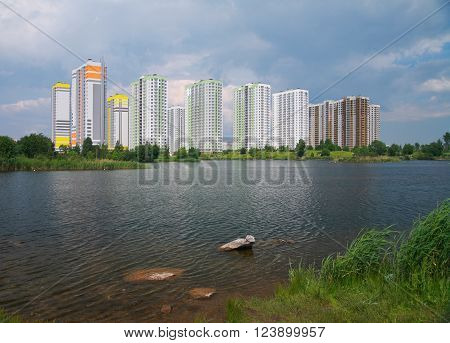 Urban Landscape multi-storey new buildings on the lake
