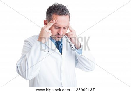 Stressed Doctor Or Medic Suffering A Headache
