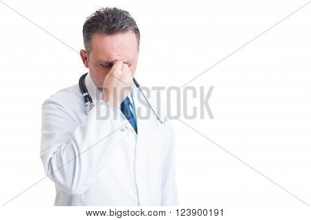 Stressed Doctor Or Medic Suffering A Migraine