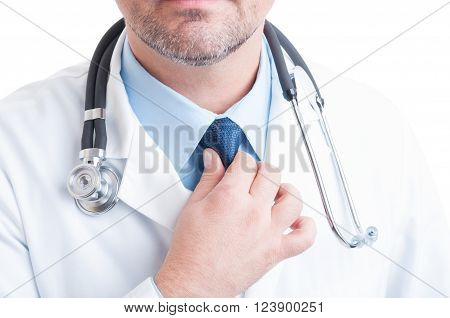Anonymous Medic Or Doctor Fixing And Adjusting The Necktie