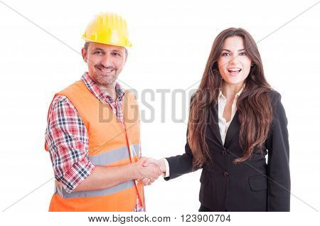 Smiling contractor and business woman shaking hands as successful partnership and teamwork concept isolated on white background