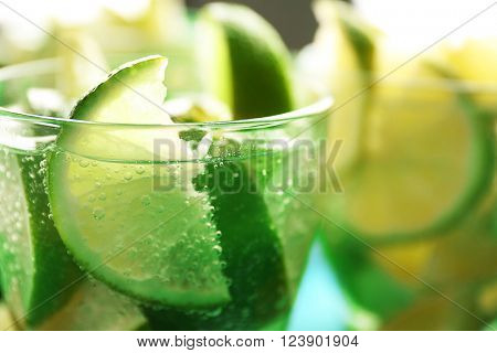 Fresh mojito drinks with lime, lemon and mint, closeup