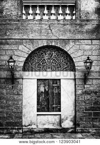Facade of an ancient Italian villa with artistic iron grill handmade.