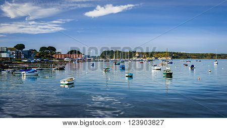 Leisure and fishing boats in Poole Harbour in Dorset looking out to Brownsea Island from Sandbanks