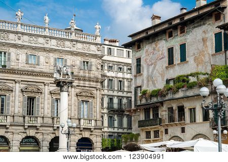 Verona Italy - September 16 2014: Detail of the baroque palace Maffei adorned with several statues of Greek gods and historic homes of Mazzanti square herbs Verona.