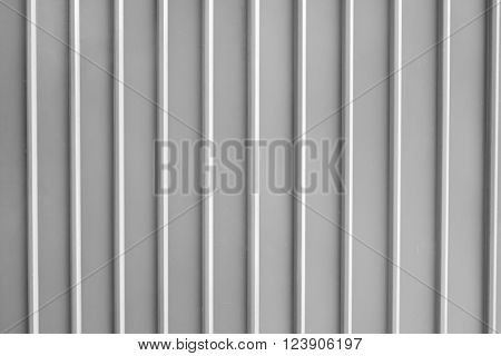 Seamless abstract background grey silver aluminium metal plate texture with vertical lines pattern.