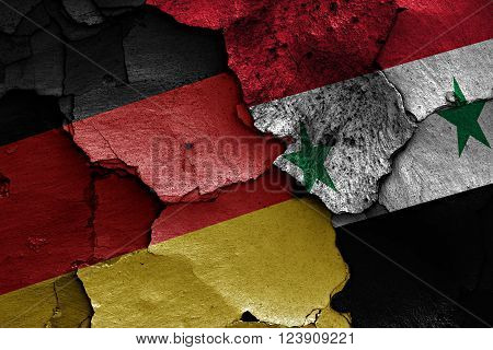 3d flags of Germany and Syria painted on cracked wall
