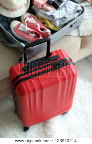 Large red polycarbonate suitcase, close up
