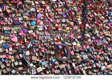 COLOGNE GERMANY - DECEMBER 30 2015: padlocks of loving couples as a sign of loyalty on the Hohenzollern Bridge in Cologne