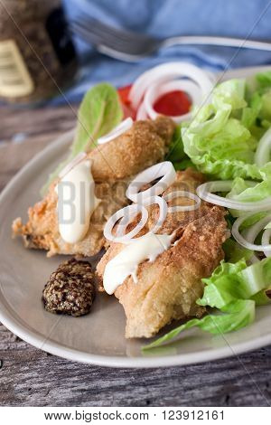 deep fried cod fish with salad mayonnaise and mustard