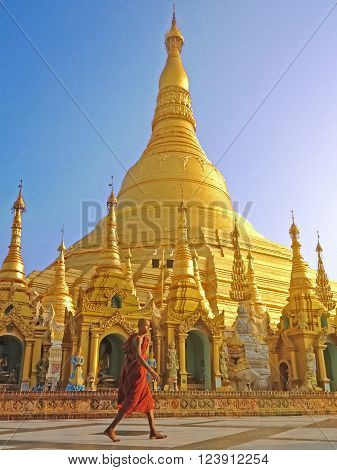 Yangon Myanmar - APR15 :  Buddhist monk walking in Shwedagon pagoda, the famous attraction in Myanmar. April 15 2013 in Yangon Myanmar.