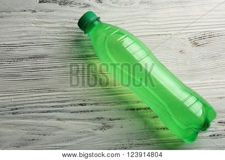 Bottled soda on the wooden table, top view
