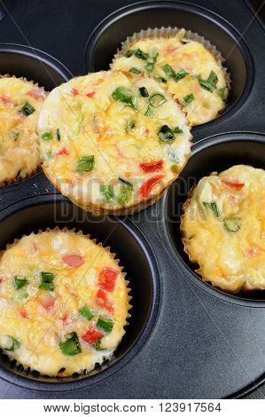 Baked vegetable casserole portion ham with cheese