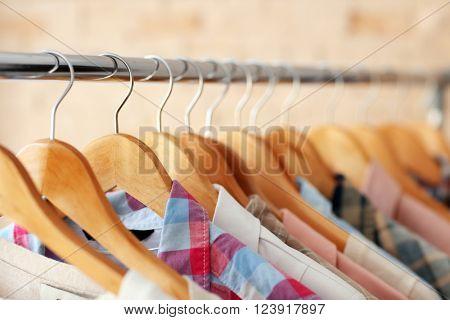 Male shirts on hangers, closeup