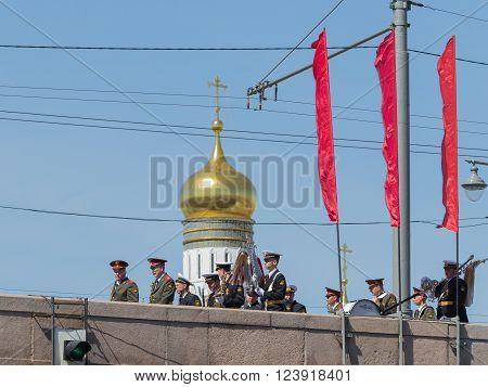 Moscow - 7 May 2015: Many soldiers and officers in stylized military uniform flow along the Great Moscow River bridge on the background of the golden dome of the Ivan the Great bell tower at a military parade May 7 2015 Moscow Russia