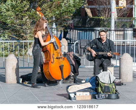 Manhattan New York - December 06 2015: Street musicians playing during lazy Sunday afternoon in Washington Square Park.
