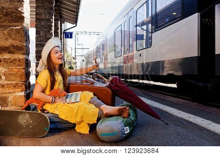 little girl waiting for the train in a deserted station