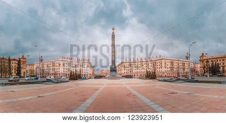 Monument in honor of the victory in World War II at Victory Square in Minsk, Belarus. Panorama. Red letters read Heroic deed of the people is immortal