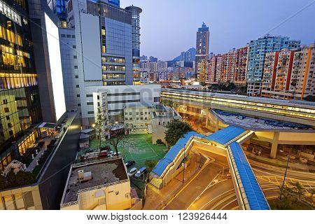Hong Kong urban city at night , train station in public living zone