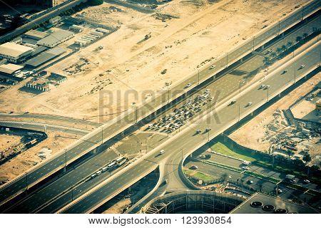 Top view of highway interchange in Dubai, UAE. Toned shot
