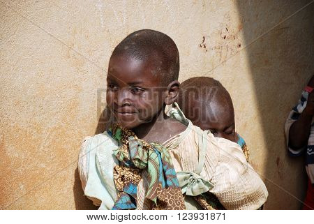 August 8 2015 Pomerini-Tanzania-Africa-Two unidentified African children normally are older children to look smaller ones neglected by parents often sick or dead of AIDS or tuberculosis
