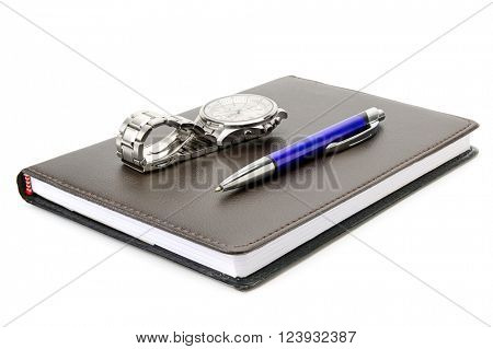 Notebook, pen and clock isolated on white