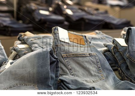Heap of blue jeans for sale in store