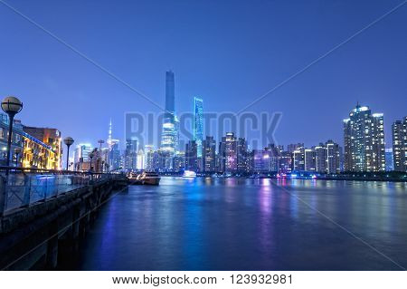 The Lujiazui skyline in Pudong new area across the Huangpu River at night in Shanghai China.
